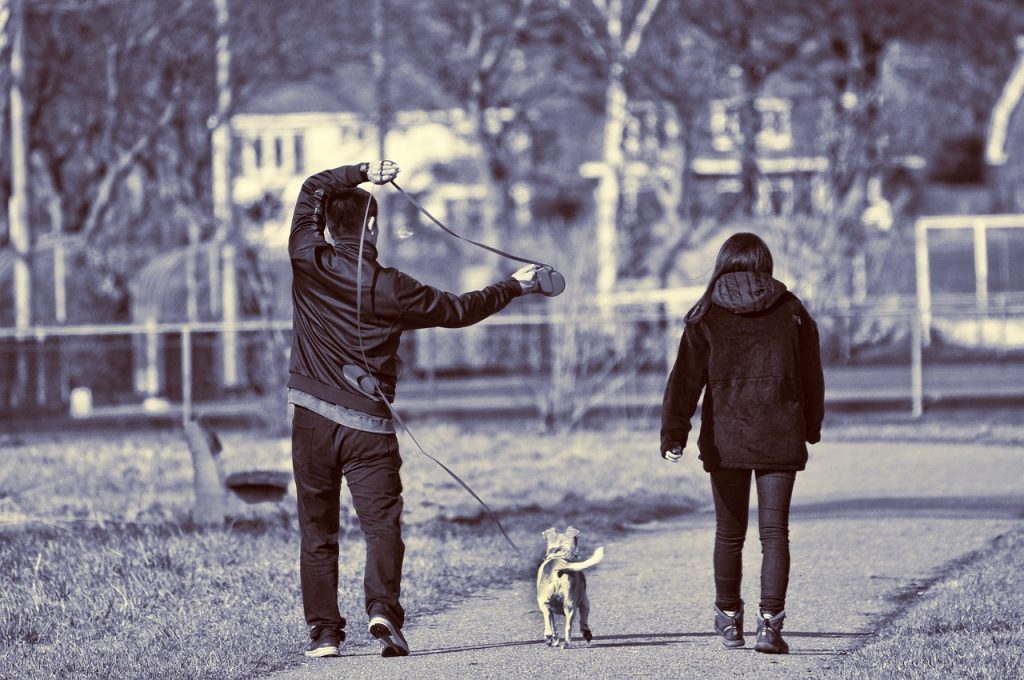 people walking dog